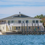 harbor house with boat dock slip