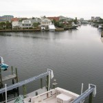 2-story canal-front townhome with boat slip/lift